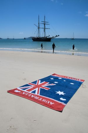 airlie: Australia Flag and a stunning view of Whitehaven Beach in the Whitsunday Islands Stock Photo