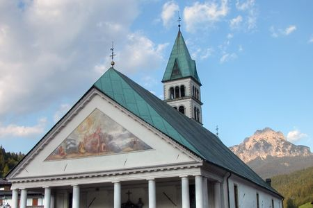 A typical church in a town of the Dolomites Mountains Banco de Imagens