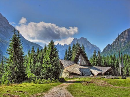 A typical Church in the middle of Dolomites Mountains