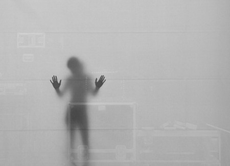 Woman Silouette with her Hands at the Wall, Sweden photo