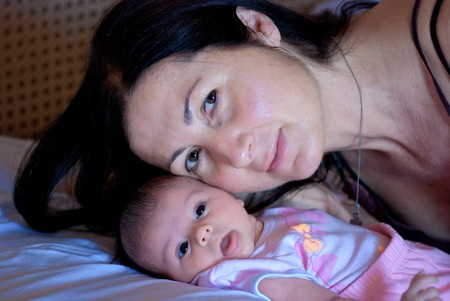 Mothers Love Behavior for her Newborn Daughter photo
