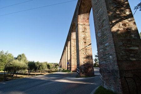 Detail of the Ancient Roman Aqueduct in Lucca, Italy photo