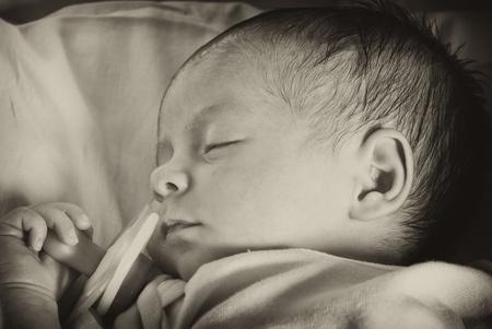 Newborn Baby Girl Sleeping in her Crib Stock Photo - 8756653