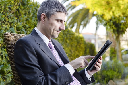 Business Man Relaxing Outdoor with his Tablet, Italy
