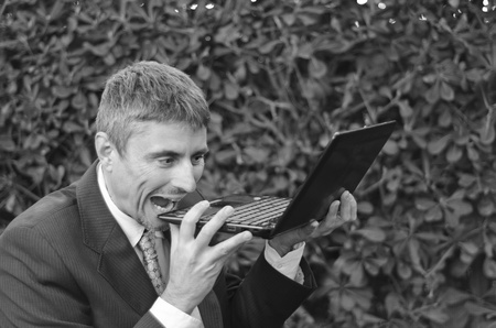 Business Man Outdoor Desperate with his Notebook, Italy photo
