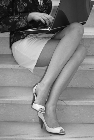 Legs of a Business Woman working with her Notebook, France photo