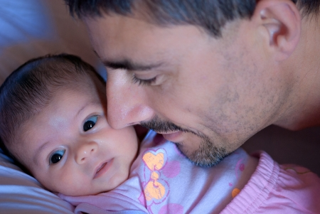holding nose: Fathers Protection Behavior for his Newborn Daughter Stock Photo