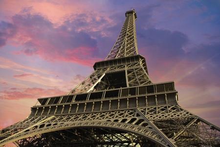 Eiffel Tower at Sunset against a Cloudy Sky, Paris photo