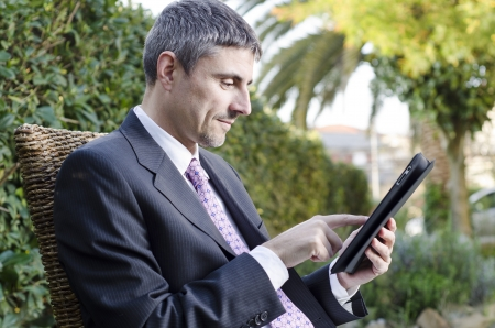Business Man Working Outdoor with his Tablet, Italy photo