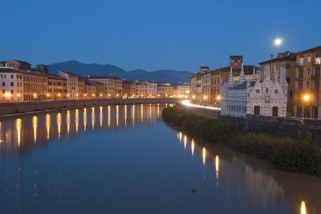 Night view of Lungarni in Pisa, Italy photo