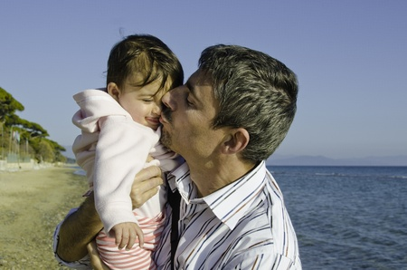 Baby with her Father on the Beach, Italy Stock Photo - 10502709