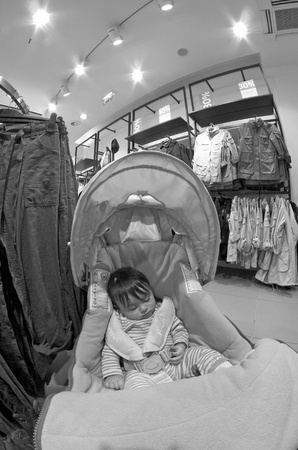 Sleeping Baby inside a Shop, Rome, Italy photo