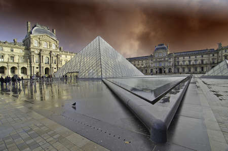 louvre pyramid: Storm over The Louvre in Paris, France
