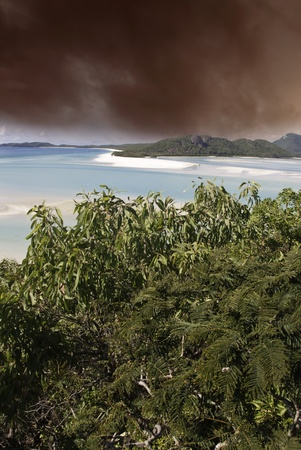Stormy Sky over Whitehaven Beach in Queensland, Australia photo
