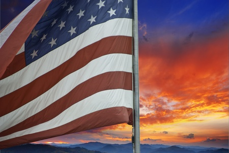 Sunset over American Flag, U.S.A. photo
