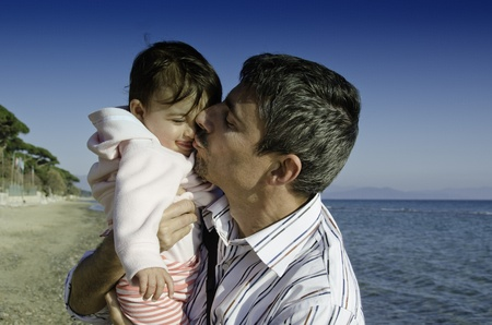 Baby with her Father on the Beach, Italy Stock Photo - 12344146