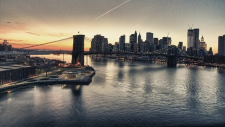Winter Sunset over Brooklyn Bridge in New York City, view from Manhattan Bridge photo