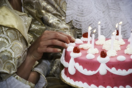 Woman Touching her Birthday Cake, France photo