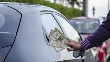Making Money Selling Cars, Man shows Dollars photo