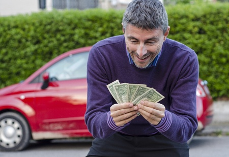 Making Money Selling Cars, Man shows Dollars photo