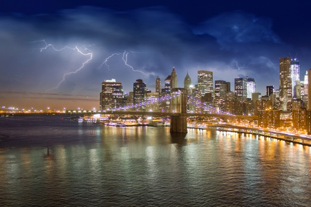 Storm in the Night over Brooklyn Bridge in New York City photo