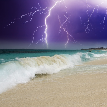 Wave on the Beach with Storm in the Background, Bahamas photo