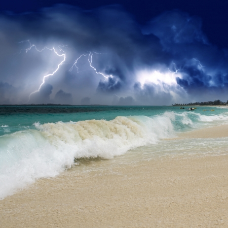Wave on the Beach with Storm in the Background, Nassau photo