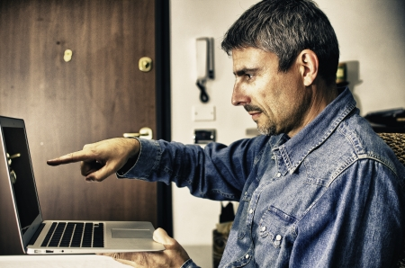 Man Working with his Notebook indoor Stock Photo - 13646353
