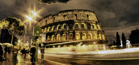 Colors of Colosseum at Night in Rome, Italy Stock Photo