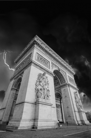 Black and White dramatic view of Arc de Triomphe in Paris, France photo