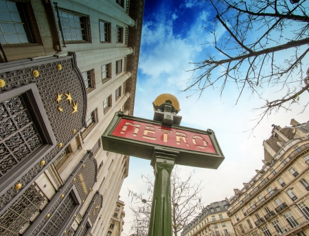 Metro Sign in Paris with Architecture in background, France