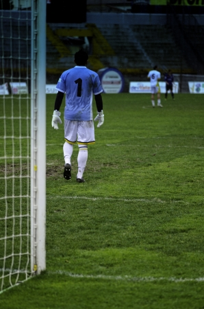 Goalkeeper Watching Soccer Match, Italy photo