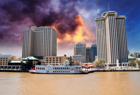 new orleans: Skyscrapers and Buildings over a Brown River, New Orleans Stock Photo