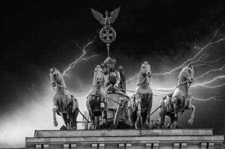 quadriga: Stormy sky above Quadriga Monument in Brandenburg Gate, Berlin