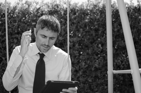 Business Man Working Outside with his Laptop and Cellphone, Italy photo