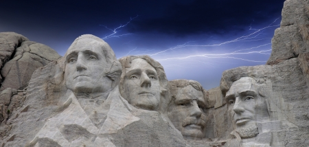 george washington statue: Dramatic sky above Mount Rushmore in South Dakota, U S A