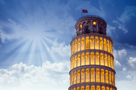 Tower of Pisa in Miracles Square, Illuminated at Night with sunset, Italy photo