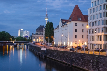 Berlin Landmarks and Buildings after sunset with river spree and deep blue sky, Germany