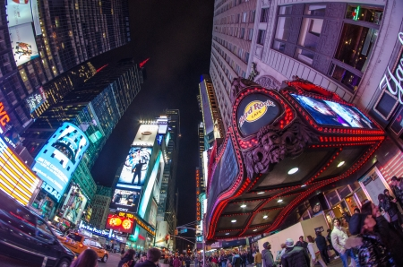 NEW YORK - MARCH 8: Illuminated facades of Broadway theaters on March 8, 2011 in Times Square, USA