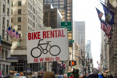 NEW YORK CITY - MARCH 9: Bike Rental sign indicates where to find a Bike in crowded Manhattan, March 9, 2011 in New York City