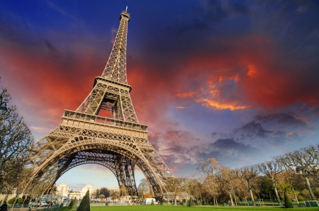 Eiffel Tower in Paris under a thunder-charged sky, France photo