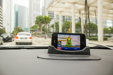 MIAMI - FEB 27: Gps Navigator shows trip directions in the middle of Miami, February 27th, 2011 in Miami, Florida