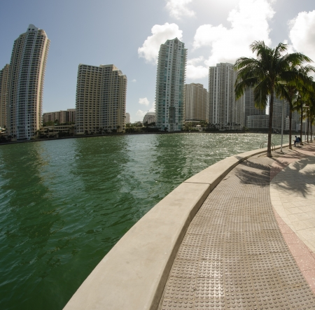 Walkway through modern buildings on a beautiful park and nature, Miami photo