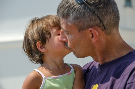 Father and Daughter kissing with love at the beach Stock Photo - 14991129