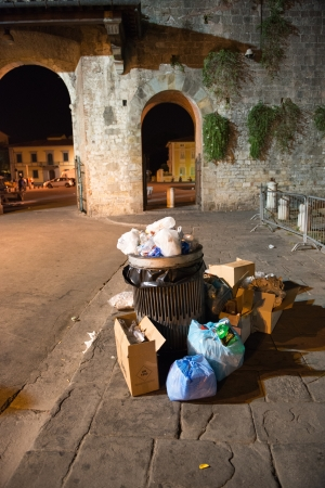 Garbage in the Street at Night - Italy photo