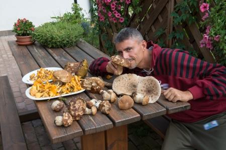 Man sniffing Boletus Mushrooms  - Italy photo
