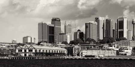 utzon: SYDNEY - AUGUST 13: Sydney Harbour Buildings view on August 13, 2010 in Sydney, Australia. The harbour is an inlet of the South Pacific Ocean and it is considered to be one of the worlds finest harbours