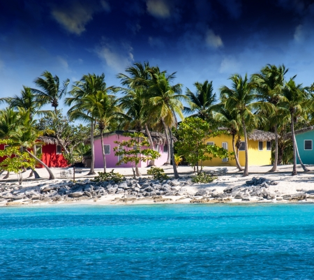 Beautiful beach of caribbean island with brilliant red, pink and yellow homes, Santo Domingo photo