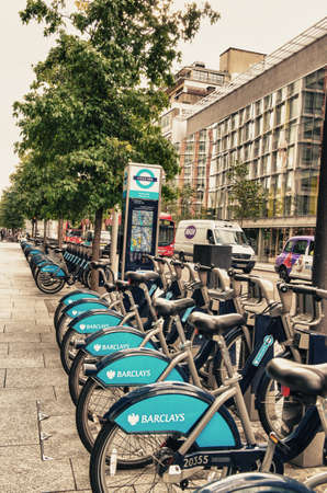 contributing: LONDON, ENGLAND - SEP 27: Detail of Londons bicycle rent docking station on September 27, 2012 in London, England. The scheme is sponsored by Barclays bank, which is contributing £25 million.