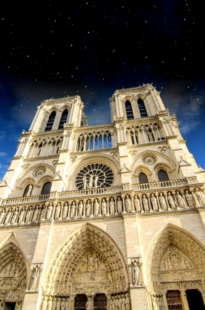 Stars in the Night above Notre Dame Cathedral in Paris photo